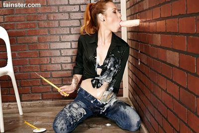 Clothed female Foxy Sanie pulls down jeans before getting pasted with semen