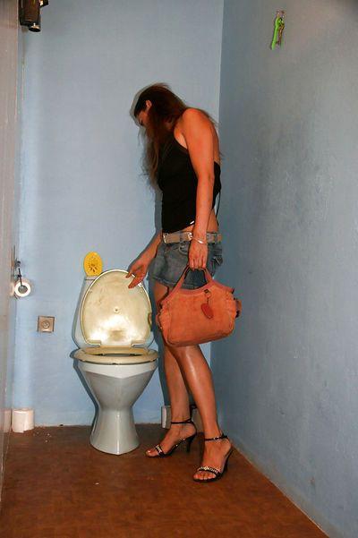 Seductive brunette slut enjoys gloryhole action in a public restroom