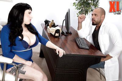 Brunette plumper unleashing huge saggy tits for interracial office sex