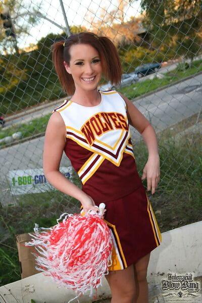 Redhead cheerleader Tweety Valentine got banged and facialed by black bulls