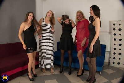 Amateur bi-women strip to hosiery prior to a reverse gangbang