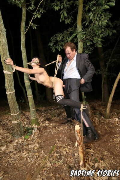 Brunette slave Khadisha Latina rope tied in the night forest for outdoor BDSM