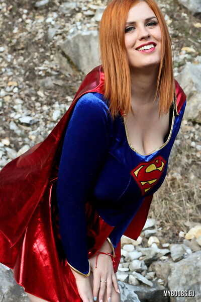 Thick redhead Alexsis Faye releases her giant tits from Superman osutfit