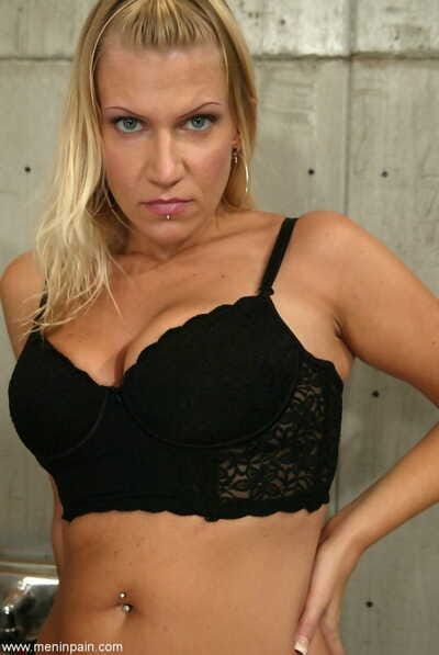 Brutal domme Xena Star in a strapon dominates her male sub with a whip