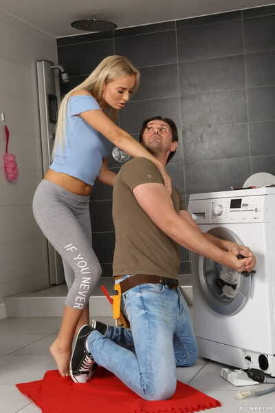 Kinky blonde Victoria Pure seduces the repairman into golden shower action