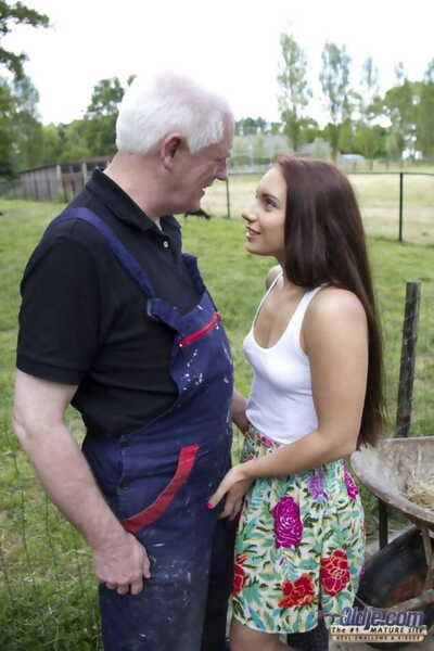 Beautiful young girl seduces her step-grandfather at the farm in rubber boots