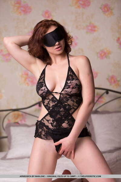 Glam model Aphrodita exposes her tits and slit before removing a blindfold