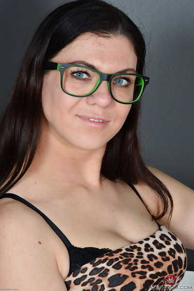 Glasses clad Corazon Del Angel freeing big mature ass and bush from skirt