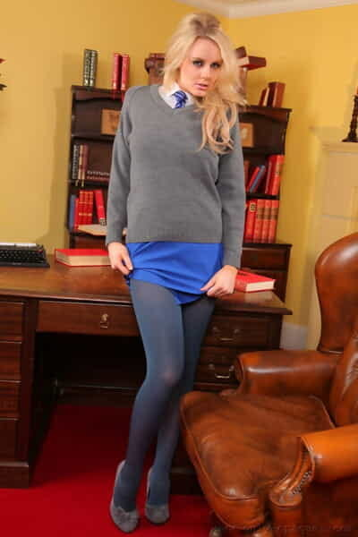 Blonde coed Amber Leigh uncovers natural tits in opaque pantyhose