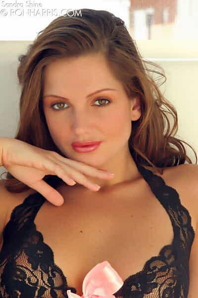 Beautiful 18 year old amateur Sandra Shine sticks a dildo in spread pussy