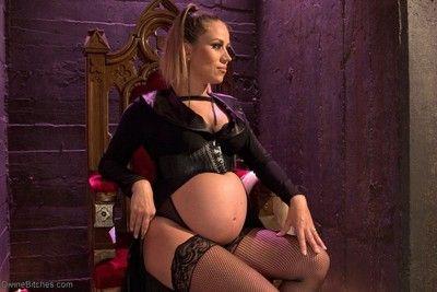 Pregnant goddess makes slaveboy worship her full belly
