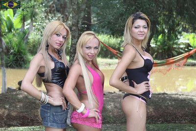 Shemale trio strips outdoors