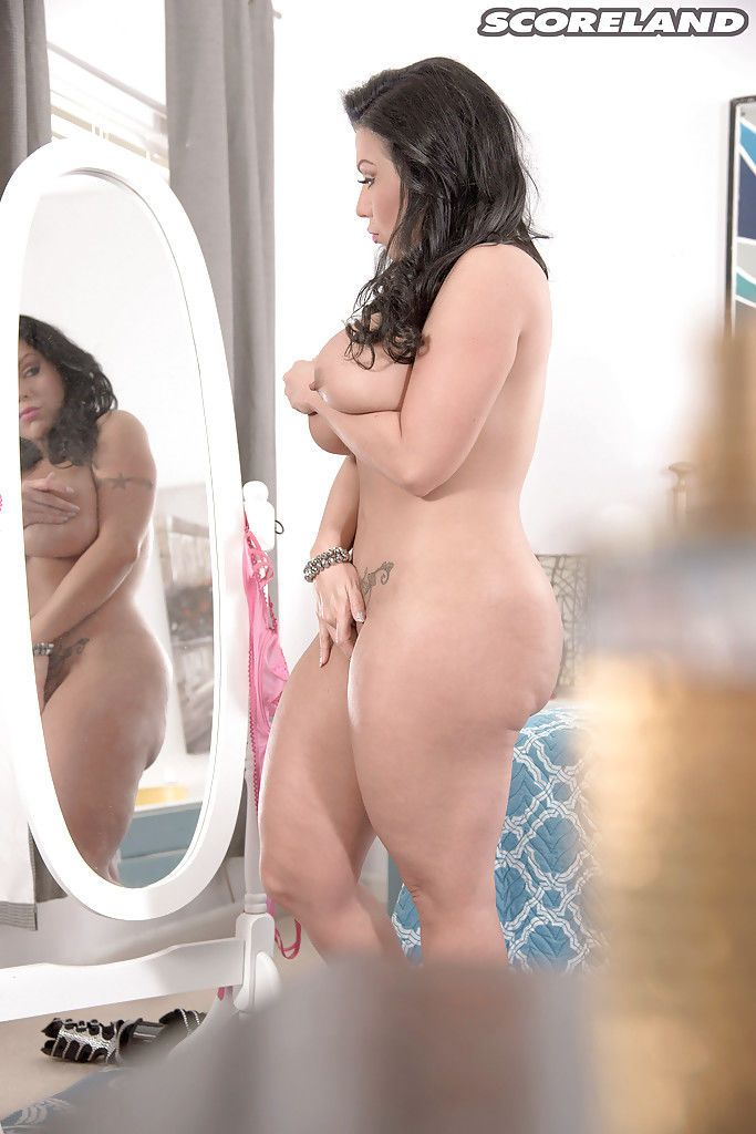 Stocking wearing brunette babe Sheridan Love frees large natural tits