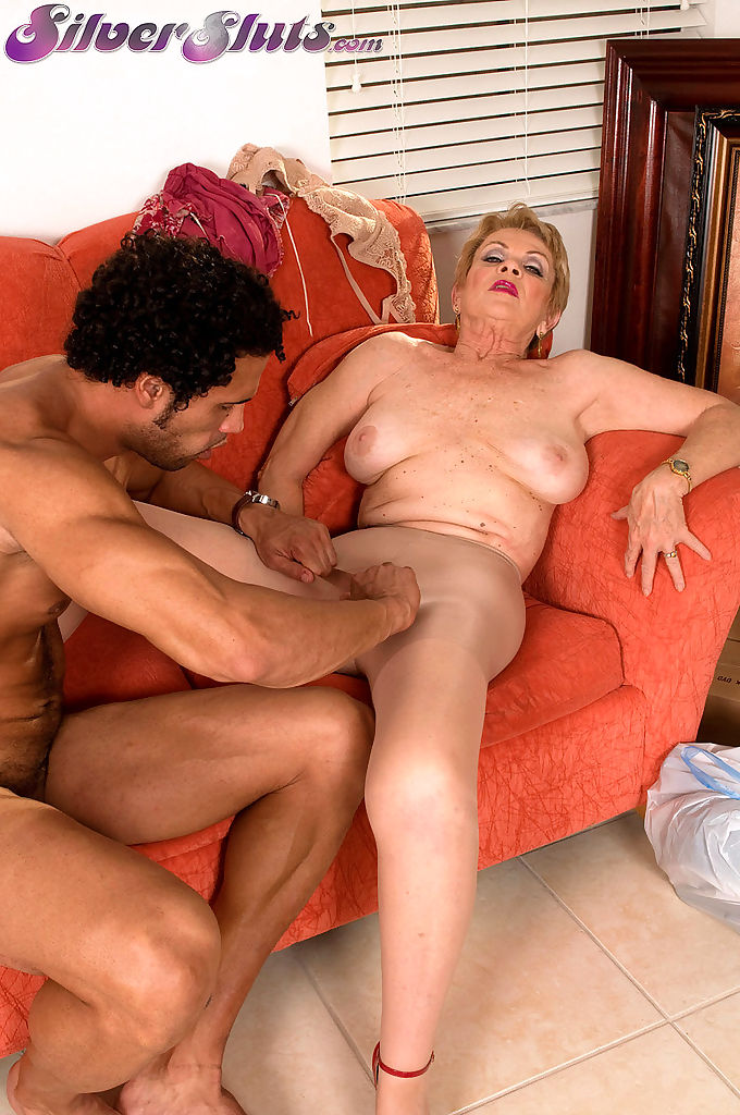 Horny grandmother Lin Boyde seduces a younger man in a short jean skirt