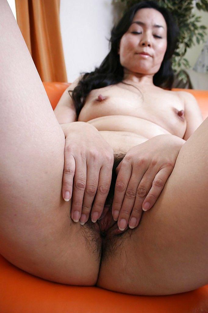 Asian MILF Takako Nishazawa posing naked and demonstrating her hairy twat