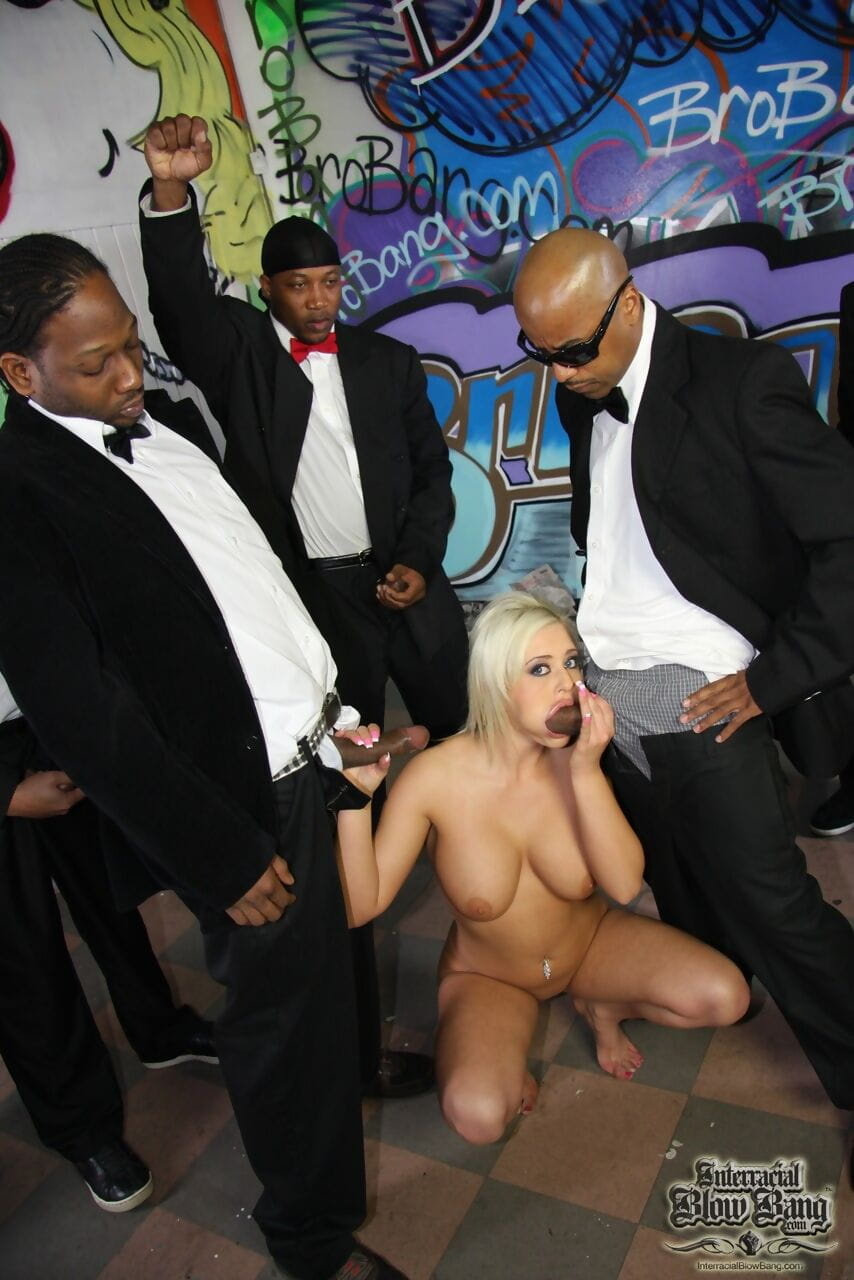 Busty Andi Anderson does a bunch of big black cocks and gets facialed