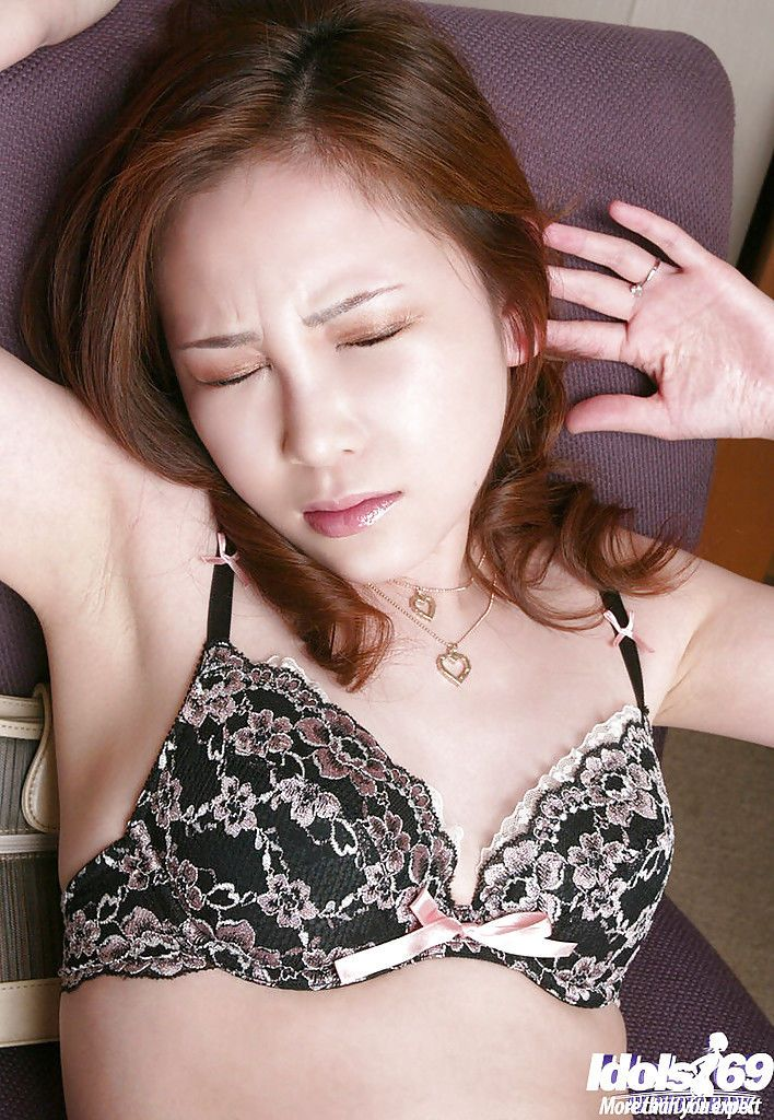 Seductive asian lassie in lacy lingerie playing with her sex toys