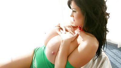 Brunette with huge tits Rachel..