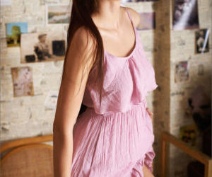 Glamour model doffs her pink dress to show perfect firm..
