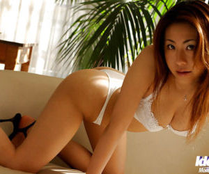 Busty asian hottie Sumire posing topless in sexy white..