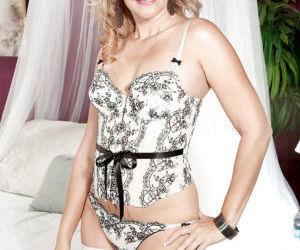 Hot older woman Valerie Rose shedding lingerie before..