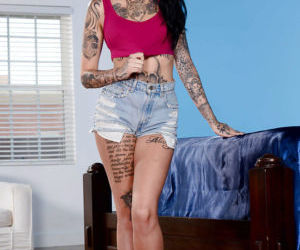 Leggy tattooed babe slipping panties and shorts over nice..