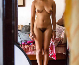 Ebony amateur Whitney captured on hidden camera dressing..