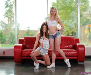 Cute lesbians Jade Nile and Alli Rae stripping off shorts..