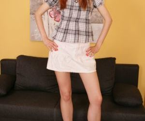Young redhead exposes her budding breasts before she..