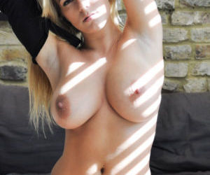 Picture- Blonde bitch taking top off.