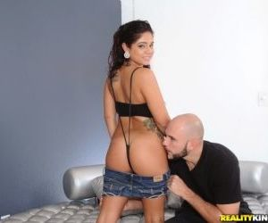 Sultry Latina Sasha De La Vega oils up her sexy ass before..