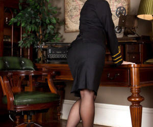 Older blonde stewardess Evey Crystal posing in stockings..