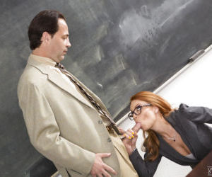 Nerdy redhead teacher Britney Amber sucking cock and balls..