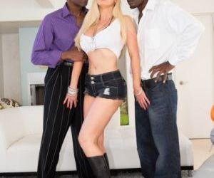 Big boobed blonde Nikki Benz sucks and fucks 2 black guys..