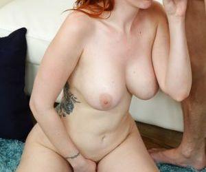 Redheaded pornstar Lauren Phillips taking anal penetration..