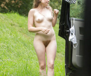 Naked female Tiffany covering her small tits and hairy..