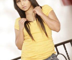 Teen Latina Lana Violet poses in her beautiful high heels..