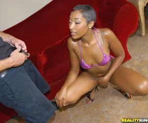 Ebony chick with short hair gives a ball sucking blowjob..