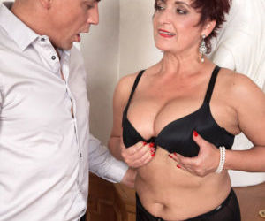 Mature lady Jessica Hot seduces a younger gentleman in her..