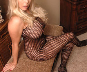 Hot MILF Amber Lynn Bach shows her pussy in a mesh..