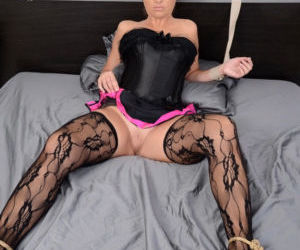 Restrained MILF in mask and bustier gets banged wearing..