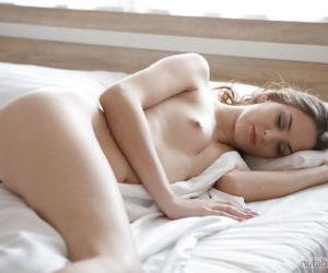 Pretty girlfriend is caught sleeping in nude by boyfriends..