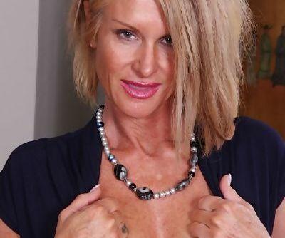 Older blonde lady Mason Vonne masturbating shaved pussy with sex toy