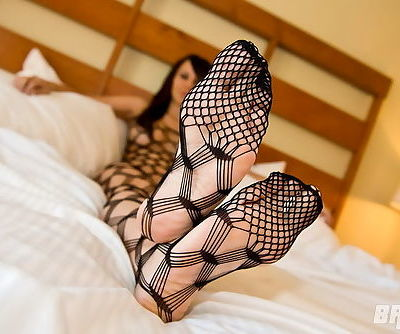 She wears a black body stocking that makes her look so good
