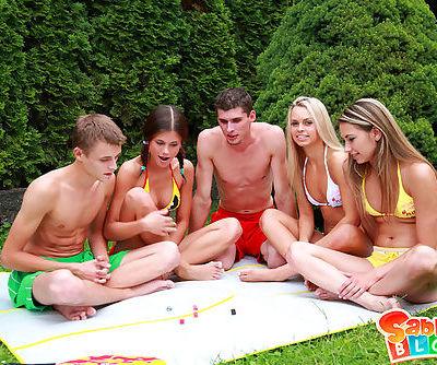 Two guys enjoying the tight holes of three hot teenies in the backyard