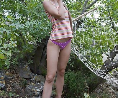 Barefoot teen Milena D strips cotton panties to masturbate in the forest