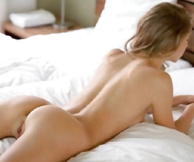 On her belly- waiting for you to do dirty things to her ass