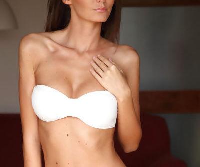 Slender brunette stunner with perfect tits Sunshine loves stripping
